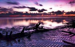 Lowtide-Sonnenuntergang Stockbild