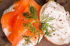 Lox and bagel with cream cheese. Smoked salmon lox with cream cheese on bagel with fresh dill Royalty Free Stock Image