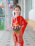 Loy Krathong festival, Asian Child girl in Thai traditional dress with holding krathong for forgiveness Goddess Ganges to celebrat. E festival in Thailand royalty free stock image