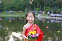 Loy Krathong festival, Asian Child girl in Thai traditional dress with holding krathong for forgiveness Goddess Ganges to celebrat. E festival in Thailand stock photos