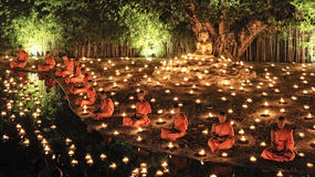 Loy Krathong festival in Chiangmai. CHIANG MAI THAILAND - NOVEMBER 28 : Loy Krathong festival in Chiangmai.Group of monks sitting meditation in the sacred ritual Royalty Free Stock Images