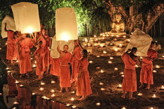 Loy Krathong festival in Chiangmai. CHIANG MAI THAILAND-NOVEMBER 28 : Loy Krathong festival in Chiangmai.Tradition al monk Lights floating balloon made of paper Stock Image