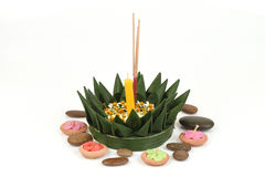 Loy Krathong Festival, krathong made of green banana leaves, yellow flowers, ornamental incense and candles. Stock Photo