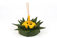 Loy Krathong Festival, krathong made of green banana leaves, yellow flowers, ornamental incense and candles. Royalty Free Stock Image