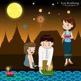 Loy Krathong festival in Thailand. People bring banana leaves vessel with candle and joss sticks floating on river Royalty Free Stock Photo