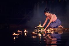 Loy Krathong Traditional Festival, Thai woman hold kratong, Thai. Land, Asia woman in Thai dress traditional hold kratong and bring Krathong to float in Loi Stock Photo
