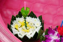 Loy Kratong Festival with banana leaves decorated with flowers stock image