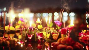 Loy Kratong Festival celebrated in Thailand. Launch boats from beautiful flowers and candles in the pond. 1920x1080, hd stock footage