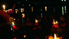 Loy Kratong Festival celebrated in Thailand. Launch boats from flowers and candles in the pond stock video