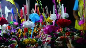Loy Kratong Festival celebrated in Thailand. Selling boat-kratong from flowers on the street market. 3840x2160. Loy Kratong Festival celebrated in Thailand stock footage