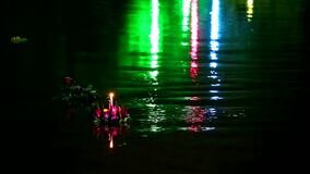 Loy Kratong Festival reflection light on the water in the lake