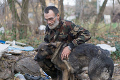 Loyal friend. Dirty homeless man with her dog royalty free stock photo