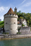 Loyal guard. Round stone tower on Lucerne lake shore Royalty Free Stock Images