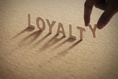 LOYALTY wood word on compressed board Stock Image