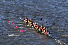 Loyola Academy Crew races in the Head of Charles Regatta Men`s Youth Eight. BOSTON - OCTOBER 23, 2016: Loyola Academy Crew races in the Head of Charles Regatta Stock Photo