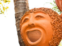 Loza de barro de la cara guau feliz Fotografía de archivo