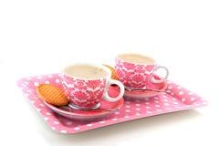 Loza rosada alegre con café fotos de archivo libres de regalías
