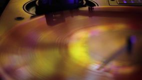 LP rotating disc in yellow and gold tones. A LP rotating disc with yellow and gold tones. Shot starts as a motion blur which then shows the disc rotating/ stock video