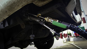 LPG fuel fill for automobile with under standard stuff  Stock Image