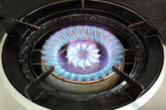 LPG Gas Burner. Hot blue fire flames from a stove for cooking in a kitchen Royalty Free Stock Images