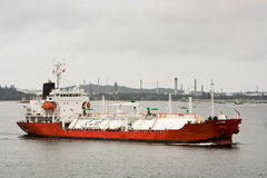 LPG gas tanker in harbour. LPG oil tanker ship under power passing refinery Stock Images