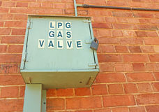 LPG gas valve container on a red brick wall Stock Photo