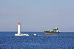 LPG (liquid petroleum gas) tanker and lighthouse Stock Photos
