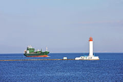 LPG (liquid petroleum gas) tanker and lighthouse Royalty Free Stock Photos