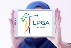 LPGA logo. Logo of LPGA on samsung tablet holded by arab muslim woman. The Ladies Professional Golf Association LPGA is an American organization for female Stock Photography