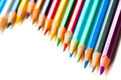 Lápices del color en un blanco Imagen de archivo libre de regalías