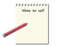 Lápiz rojo en la nota, nota al uno mismo Imagen de archivo libre de regalías