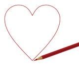 Lápiz y corazón rojos Fotografía de archivo libre de regalías