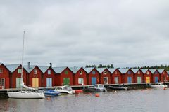 Red boathouses Stock Photos