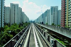 LRT train railings with apartments. LRT train railings surrounded by apartments, at Punggol Stock Image