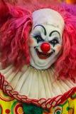 Läskig clowndockaframsida Arkivfoton