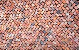 Färgrik vägg av löst travde tegelstenar Arkivbild