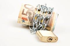 låsta pengar Arkivfoto