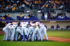 LSU Baseball Huddles. LSU baseball team huddles before their game time match up with Holy Cross.  http://www.lsusports.net Stock Image