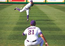 LSU Baseball Pitcher warm ups. LSU baseball team members warm up before their game time match up with Holy Cross.  http://www.lsusports.net Stock Photo