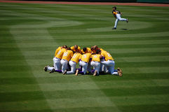 LSU Huddle. Six time LSU Baseball Tiger champions huddle before the Tennessee game on Saturday, May 14, while Tennessee player warms up in background Stock Images