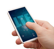 LTE Mobile Internet in Smartphone. LTE Mobile Internet - Man's Hand With Smartphone With LTE Sign on Display - Isolated on White with clipping path royalty free stock photos