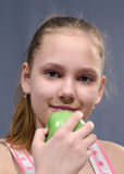 Lteen girl with green apple in her hand Royalty Free Stock Images
