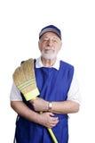 Ältere Arbeitskraft - mit Besen Stockbild