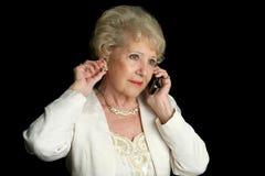 Ältere Dame Multitasking Stockbild