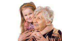 Ältere Frau mit der Enkelin Stockfoto