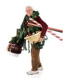 Älterer, der sich glücklich für Weihnachten vorbereitet Lizenzfreie Stockfotos