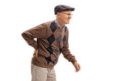 Älterer Mann, der Rückenschmerzen erfährt Lizenzfreie Stockfotografie