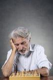 Älterer Schachspieler Stockfoto