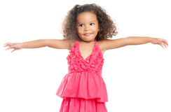 Lttle girl with an afro hairstyle laughing with her arms extended Stock Photo
