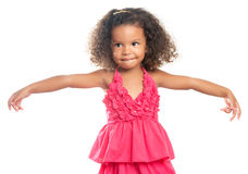 Lttle girl with an afro hairstyle laughing with her arms extended Royalty Free Stock Photos